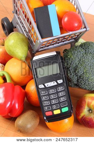 Payment Terminal, Credit Card Reader With Contactless Credit Card And Fruits And Vegetables With Pla