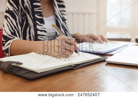 Business And Finance Concept Of Office Working, Businesswoman Discussing Investment Analysis Chart