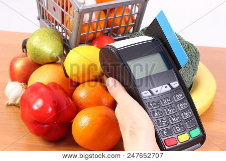 Using Credit Card Reader, Payment Terminal With Credit Card And Fruits And Vegetables With Plastic S