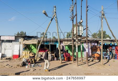 Addis Ababa, Ethiopia, January 30, 2014, Small Shops On A Dirt Road With A Few Informal Traders Near