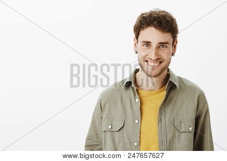 Charming Emotive Guy With Beard And Beautiful Blue Eyes Smiling Joyfully And Smiling Broadly At Came