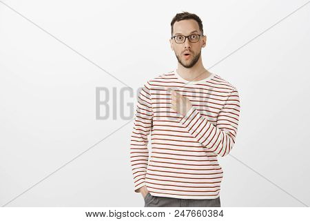 Portrait Of Amazed Impressed Handsome Gay Man With Bristle In Black Glasses, Saying Wow While Pointi
