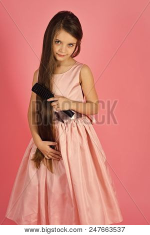 Baby Shampoo. Fashionable Girl Posing. Girl Child Brush Hair In Fashionable Dress On Pink. Little Gi
