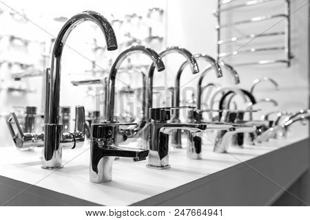 Rows of new faucets in plumbing shop, closeup