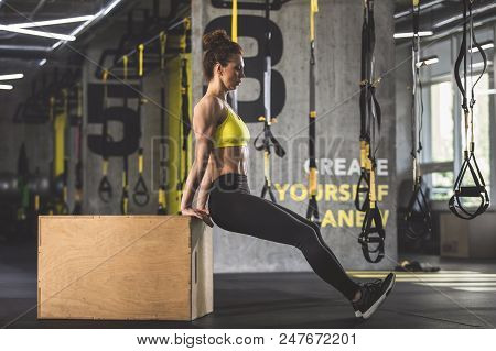 Full Length Side View Serious Female Athlete Making Physical Exercise While Locating In Gym