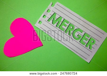 Conceptual Hand Writing Showing Merger. Business Photo Showcasing Combination Of Two Things Or Compa