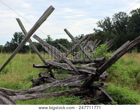 An Old Log, Civil War Style Fence With Overgrowth