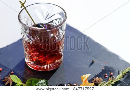 Close-up Of Classic Alcoholic Godfather Cocktail In Rocks Glass On Blue Background, Shallow Dof