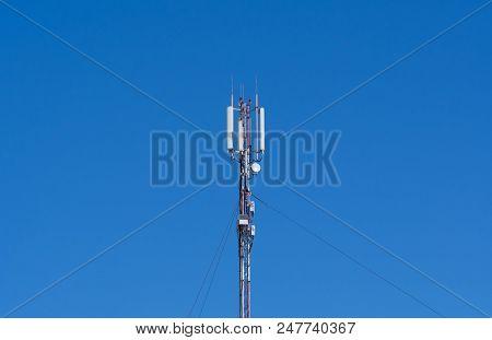 upward of Communication Radio antenna Tower , microwave antenna tower on blue sky background poster