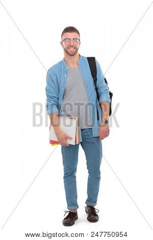 A male student with a school bag holding books isolated on white background. Education opportunities. College student.