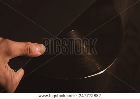 Vintage Vinyl Disk In Hands Close Up.