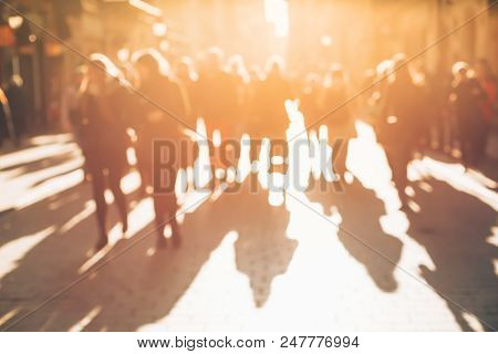 Blurred Background Made Of People Walking Through The City