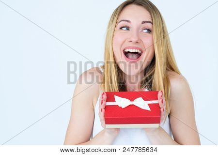 Thrilled And Excited Woman With A Gift Box. Surprise Present On Birthday Or Women Day. Emotions And