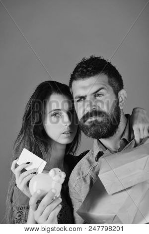 Couple In Love Holds Shopping Bags On Blue Background. Man With Beard Holds Credit Card And Money Bo
