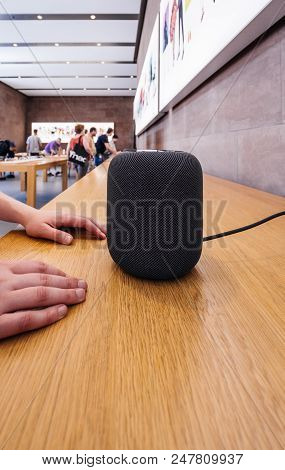 Paris, France - Jun 30, 2018: Woman Admiring In Apple Store The Latest Apple Computers Homepod Smart