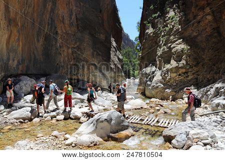 Samaria, Greece - May 21, 2014: Tourists Hike In Samaria Gorge In Crete, Greece. The National Park I