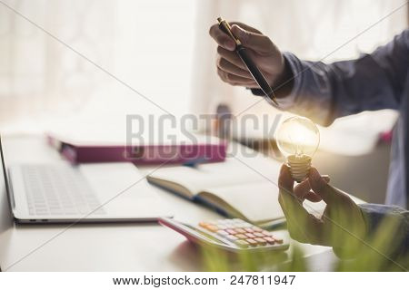 Concept Creativity And Innovative Or Idea. Businesswoman Hand Holding Light Bulb With Light Bulbs Of