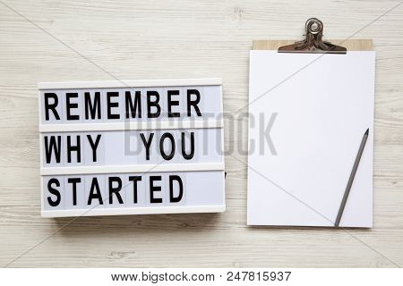 Noticeboard, Pencil And 'remember Why You Started' Words On Lightbox Over White Wooden Background, F