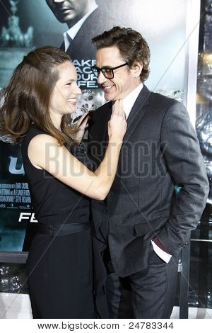 LOS ANGELES - FEB 16: Robert Downey Jr and wife Susan Downey at the premiere of 'Unknown' held at the Regency Village Theater in Los Angeles, California on February 16, 2011