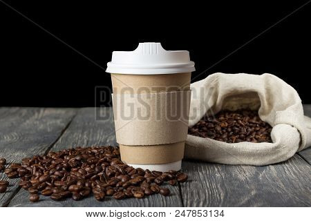 Coffee Beans In Bag And On Wooden Table, A Special Cup For Coffee