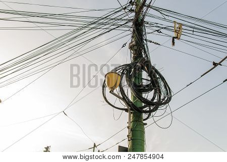 Electricity Pole And Street Light Complicated Wiring On The Pole 1