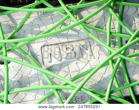 Melbourne, Australia - May 14, 2018: Green Nbn Fibre Optic Cable In A Unstructured Mess Over A Pit W