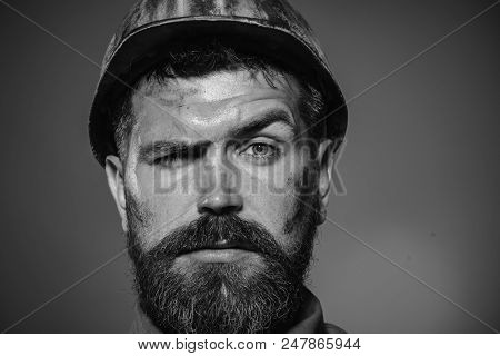 Builder Working With Construction Helmet. Close Up Engineers Working. Builder In Protective Clothing