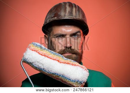 Painter Holds Paint Roller. Interior Design, Repair, Building And Home Renovation Concept - Decorato