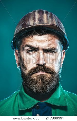 Construction Worker In Hard Hat. Builder In Protective Clothing And Helmet. Male Builder. Portrait B