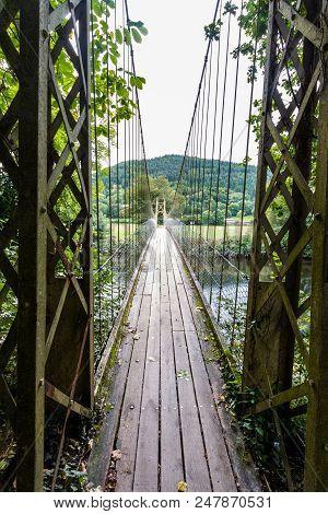 Looking Along Wooden Suspension Bridge Walkway.
