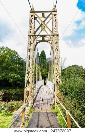 Suspension Bridge Over The River Conwy, In Betws-y-coed, Gwynedd, North Wales, Uk