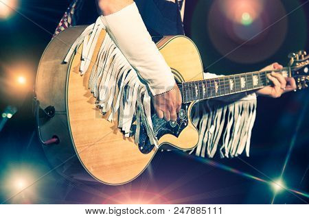 Woman Guitarist In The Country Band During A Show