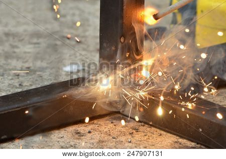 Spark From Weld Work When Welder Welding An Iron, Steel Structure In A Construction Site, Industrial
