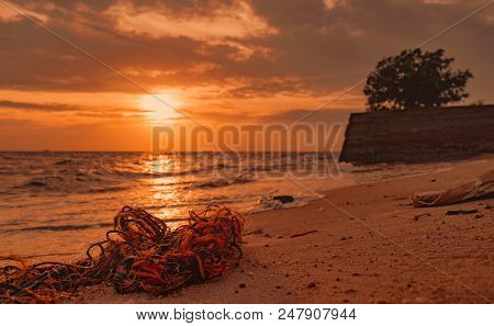 Garbage On The Beach. Coastal Environmental Pollution. Marine Environmental Problems. Old Rope On Sa