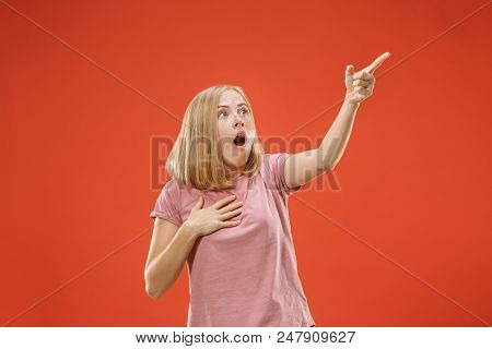 Screaming. Crying Emotional Angry Woman Pointing Up And Screaming On Red Studio Background. Emotiona