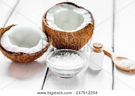 Natural Coconut Oil For Body Care In Organic Cosmetic Concept On White Desk Background