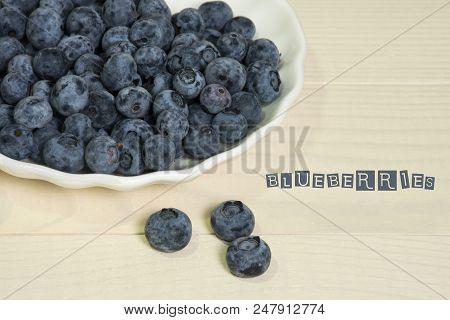 Blueberries summer berry on wooden table. Fresh organic antioxidant ecologic food. Vitamin C, E, P, PP, B carotene flavonoids ascorbic acid poster
