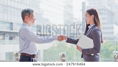 Business People Smile Happily And Shake Hands