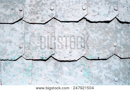 Metal Background With Hammered Metal Plates With Rivets On The Metal Surface Covered With Grey Peeli