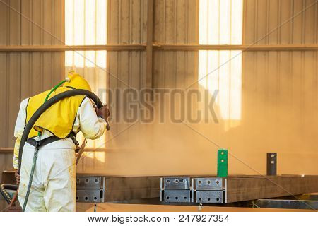 Sand Blasting Process, Industial Worker Using Sand Blasting Process Preparation Cleaning Surface On