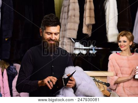 Woman In Pink Fur Coat With Bearded Man In Shop. Couple Shopping Concept. Couple In Love: Lady And M