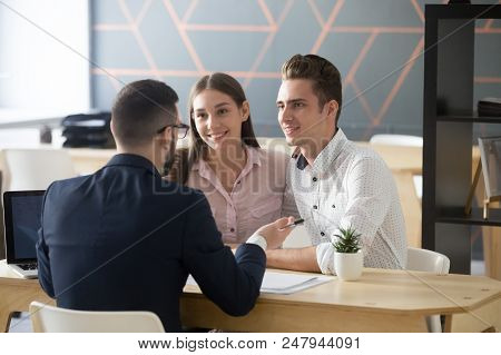 Insurance Agent Or Broker Consulting Smiling Millennial Couple On Property Purchase, Realtor Discuss