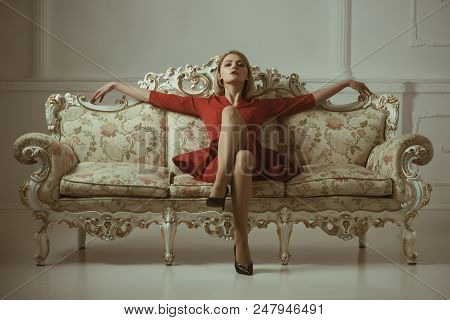 Realtor Company. Woman Realtor In New Apartment. Come Home With Confidence. Woman On Sofa Presenting