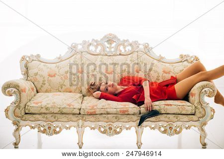 Vintage Sofa Furniture. Woman Relax On Vintage Sofa. Vintage Interior Design. Luxury Woman On Vintag