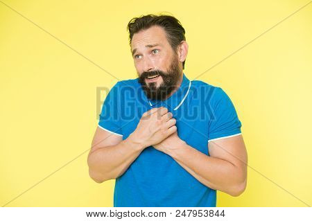 Feel So Sorry. Man Bearded Regretful Face, Yellow Background. Guy Bearded Sorry Gesture. Ask For Apo