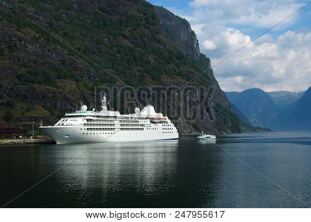 Cruise Liner In Sea Port On Mountain Landscape In Flam, Norway. Holiday Ship In Sea Harbor With Gree