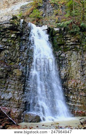 Waterfall With Water Falling From Cliff. Manyavskii Waterfall In Carpathian Mountains. Water Falling