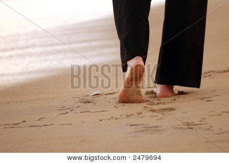 Woman Walking On The Sand Beach