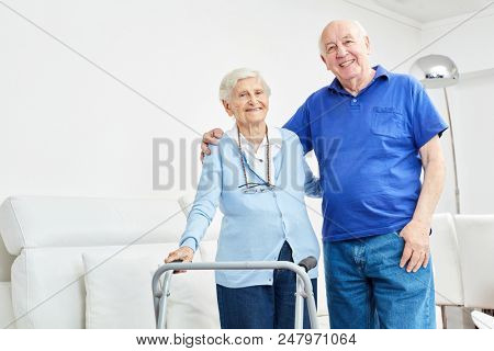 Senior couple as a happy couple in the retirement home or at home