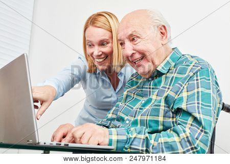Senior Senior At Laptop Computer Having Fun Video Chat In Social Media